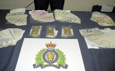 Cash and Gold Bars Seized During Heaven's Stairway Bust